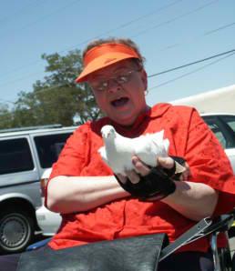 Senior Woman holding bird in hand